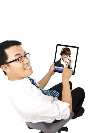 Businessman using video conference with  Customer service by flat touch pad photo