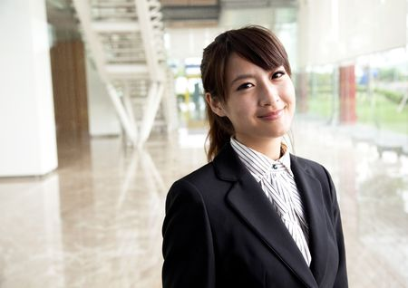 young and smiling business woman Standing in front of the office photo