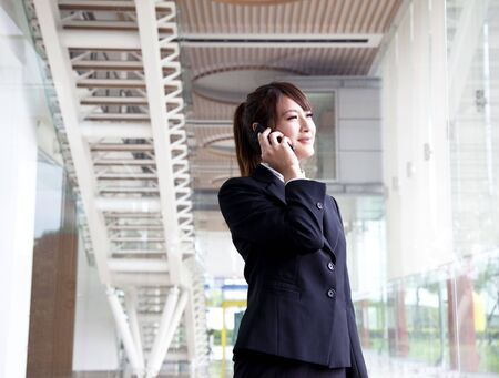 smiling bussinesswoman talking on the phone Stock Photo - 8059917