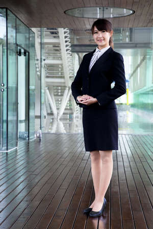 Fullbody business woman smiling and stand in morden office Stock Photo - 8059919
