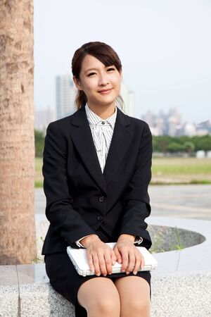young and smiling businesswoman  holding a laptop Stock Photo - 8127136