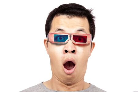 aghast: Young man with 3D glasses on watching a 3D movie