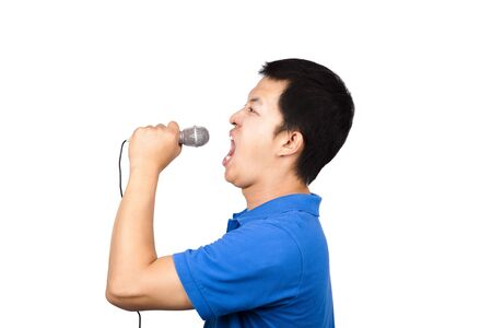 Young man with a microphone singing photo