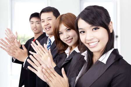 Business people applauding and welcome new partner photo