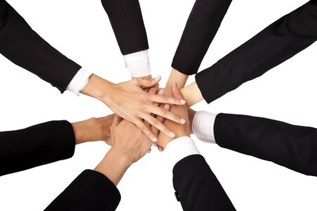 The concept of teamwork and Cooperation. Teammate's Hands on top of each other. Stock Photo - 8186786