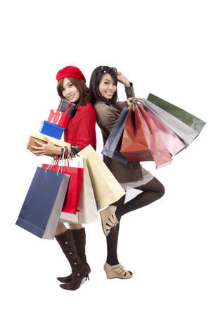 Two happy shopping  beautiful girls with the bags  photo