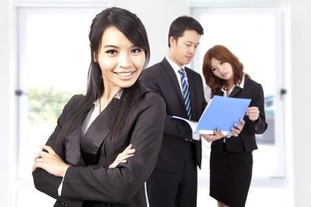 copyspace corporate: Young and smiling Business woman in an office