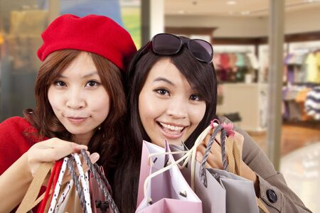mall: Two happy girls in a shopping center  Stock Photo