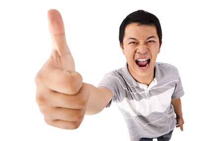gives: Im Best.Happy  young man gives his thumbs up