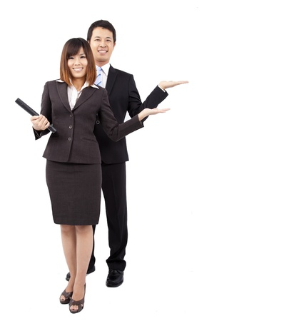 asian office lady: young smiling businesswoman and businessman. with their hand outstretched and presenting something