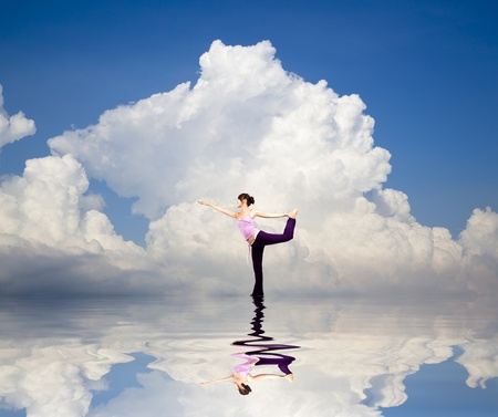 yoga girl on the water and Reflection with cloud background  photo