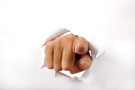 accuse: hand break through the white paper with finger pointing to the you