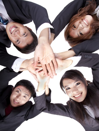 Asian Young Business people joining their hands photo