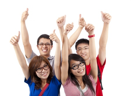 asian success: Happy students showing thumbs up and isolated on white background Stock Photo