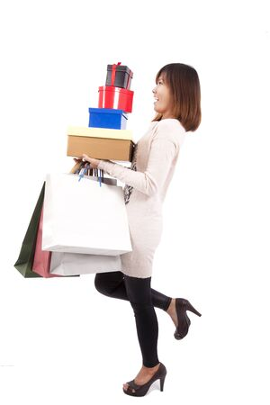 Young happy shopping woman with a lot of gift box and shopping bag photo