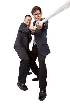 tugging: Two businessman work together and playing tug of war