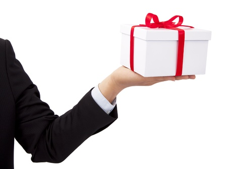 Businessman holding and offer  a gift  photo