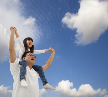 young asian girl: Asian father and daughterunder cloudfield  Stock Photo