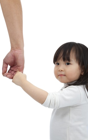 parent and child: Little girl holding the hand of the father and looking back