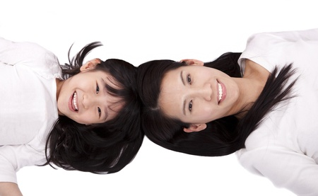 Beautiful mother and daughter lying on the white background Stock Photo - 8543510