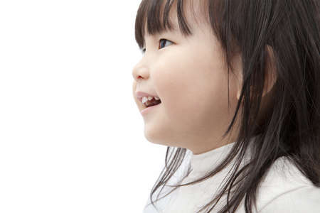 Beautiful asian little girl watch and smiling isolated on white background Stock Photo - 8543512