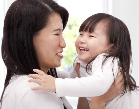 Close-up of asian little girl and  her mother Stock Photo - 8564546