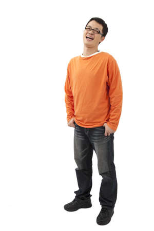 Asian young man standing with hands in pockets isolated on white background  photo