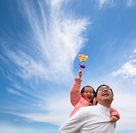 happy asian family: Happy girl and father with cloud  background