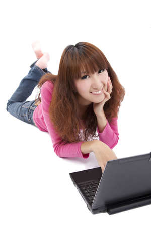Pretty Asian girl lying on the floor with laptop Stock Photo - 8655997