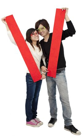 Happy Chinese new year. Young Asian couple holding  blank spring festival couplets  photo