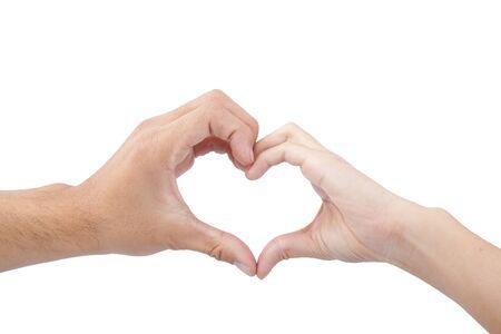 corazon en la mano: concepto de amor y de coraz�n. manos de hombre y mujer, formando un coraz�n aislado en fondo blanco Foto de archivo