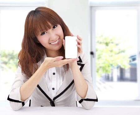 Beautiful woman holding a smart cell phone  photo
