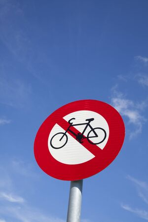 obey: No bicycle sign with blue sky background Stock Photo