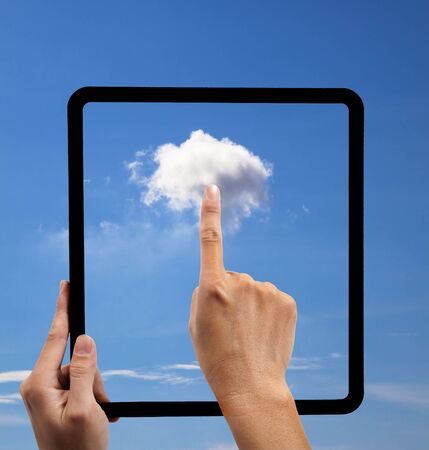 cloud computing and touch pad concept. hand holding black empty frame and touch the cloud photo