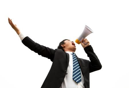 noise: young Businessman make loud noise by megaphone