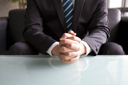 interview: Holding hand of businessman