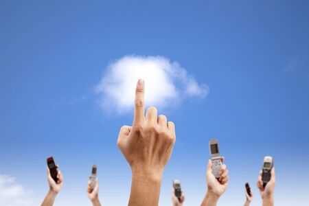 Hand touch the cloud and holding mobile phone. cloud computing and smart phone concept photo