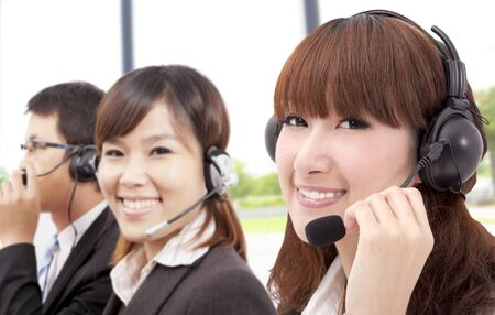 customer services: Similing business customer service team on the phone