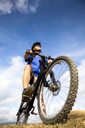 Mountain Biker and blue sky background photo