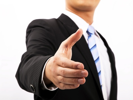offering: Close up of business man extending  hand to shake
