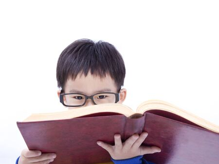 Asian boy Concentrate on studying with book photo
