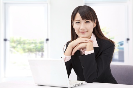 Beautiful businesswoman with laptop photo