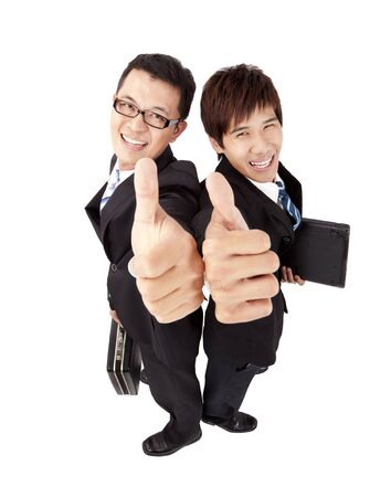 Two successful  businessman with thumb up photo