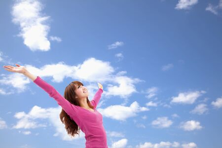 arms in air: Beautiful Asian Young Woman over blue Sky and relax