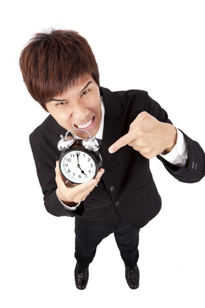 Time to go home.businessman holding a clock Stock Photo - 9164987