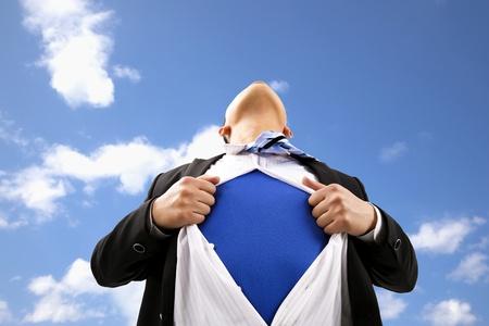 open shirt: Businessman pulling  his t-shirt open