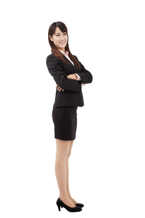 Portrait of a confident young business woman isolated on white background photo