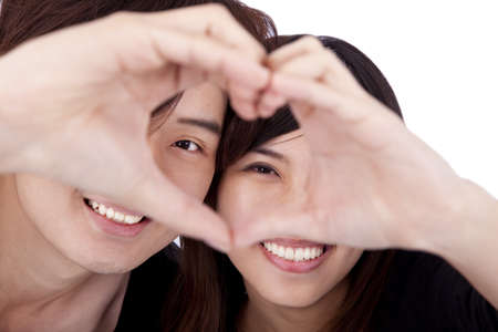 adult dating: Happy couple forming heart by touching hands together