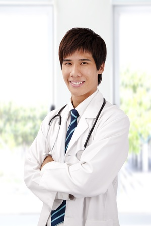 Asian young doctor with stethoscope Stock Photo - 9319243