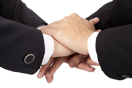 hands clasped: Trust and cooperation  concept. stacked hands of businessman